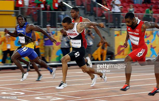 Andre De Grasse of Canada crosses the finish line to win the gold medal in the men's 100 meter final during Day 12 of the Toronto 2015 Pan Am Games...