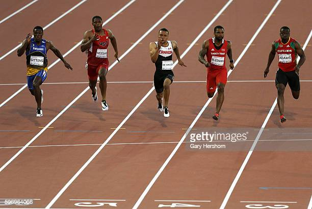 Andre De Grasse of Canada runs to the finish line ahead of Ramon Gittens of the Barbados Remontay McClain of the USA Keston Bledman of Trinidad and...