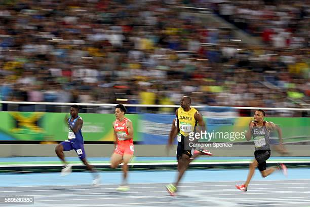 Andre De Grasse of Canada, Usain Bolt of Jamaica, Ryota Yamagata of Japan and Trayvon Bromell of the United States compete in the Men's 100 meter...