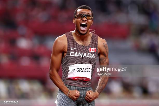 Andre de Grasse of Team Canada celebrates after winning the gold medal in the Men's 200m Final on day twelve of the Tokyo 2020 Olympic Games at...