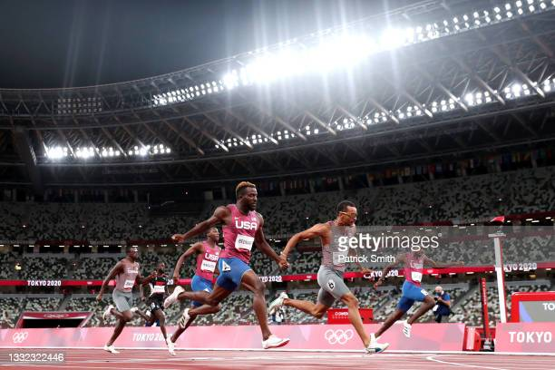 Andre de Grasse of Team Canada finishes ahead of Kenneth Bednarek of Team United States to win the gold medal in the Men's 200m Final on day twelve...