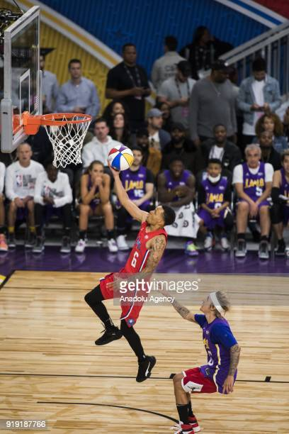 Andre De Grasse of Team Clippers goes for a lay up against Justin Bieber of Team Lakers during the 2018 NBA AllStar Celebrity Game as part of AllStar...