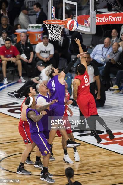 Andre De Grasse of Team Clippers goes for a lay up as Kris Wu of Team Lakers attempts a block during the 2018 NBA AllStar Celebrity Game as part of...