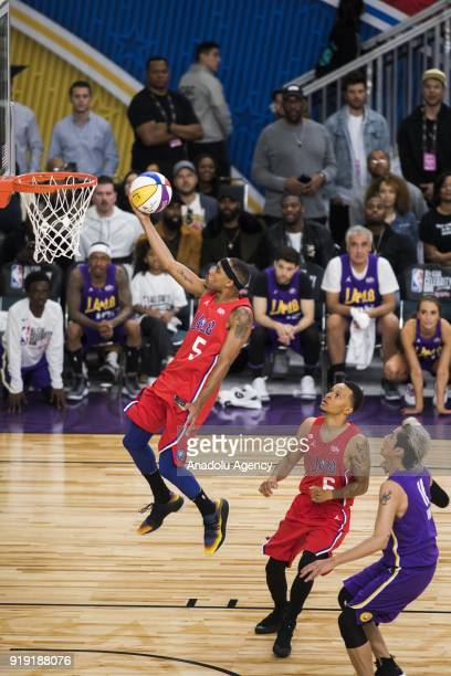 Andre De Grassev of Team Clippers makes a lay up during the 2018 NBA AllStar Celebrity Game as part of AllStar Weekend at the Los Angeles Convention...