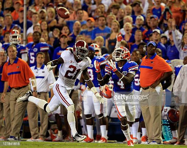 Andre Debose of the Florida Gators attempts to make a reception against Dre Kirkpatrick of the Alabama Crimson during a game at Ben Hill Griffin...