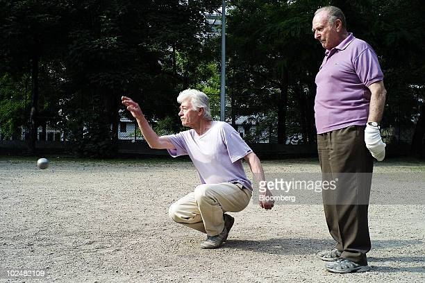 Andre Demoinerie right and Albert Manthe play petanque in a park in Paris France on Saturday June 26 2010 France's plan to lift its retirement age is...