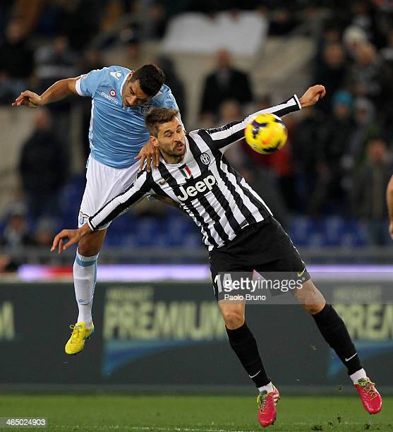 Andre' Dias of SS Lazio competes for the ball with Fernando Llorente of Juventus during the Serie A match between SS Lazio and Juventus at Stadio...