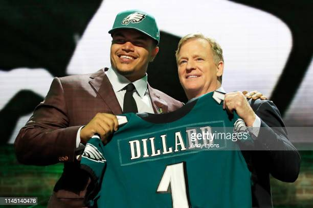 Andre Dillard of Washington State poses with NFL Commissioner Roger Goodell after being chosen overall by the Philadelphia Eagles during the first...