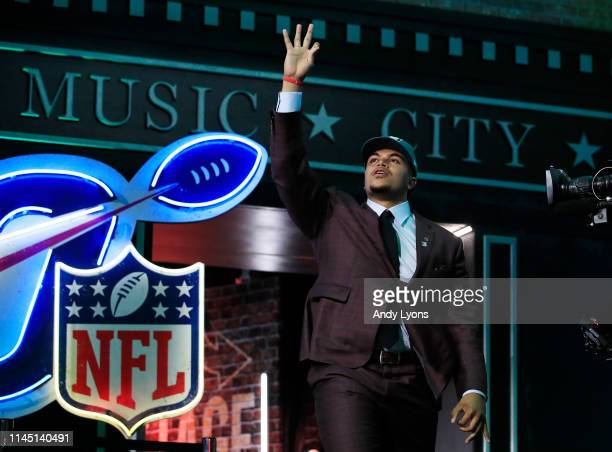 Andre Dillard of Washington State reacts after being chosen overall by the Philadelphia Eagles during the first round of the 2019 NFL Draft on April...
