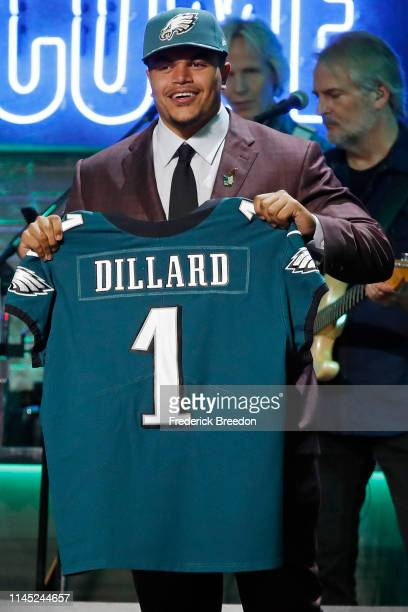 Andre Dillard poses with a jersey after being selected by the Philadelphia Eagles with pick 22 on day 1 of the 2019 NFL Draft on April 25 2019 in...