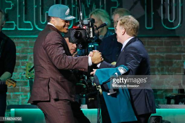 Andre Dillard shakes hands with NFL Commissioner Roger Goodell after being selected by the Philadelphia Eagles with pick 22 on day 1 of the 2019 NFL...