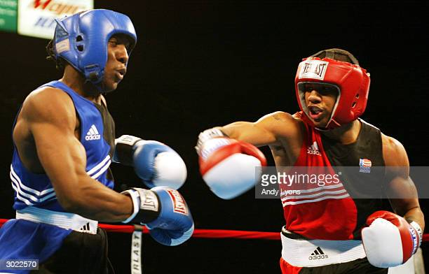 Andre Dirrell of Flint Michigan lands a punch in his middleweight match against Clarence Joseph during the 2004 Olympic BoxOffs at the Cleveland...