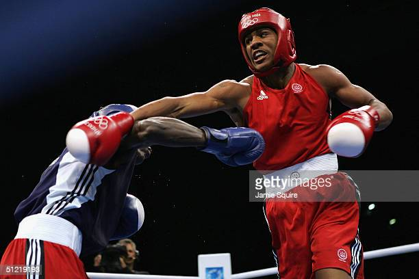 Andre Dirrell of USA battles Yordani Despaigne Herrera of Cuba during the men's boxing 75 kg quarterfinal bout on August 25, 2004 during the Athens...