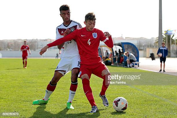 Andre Dozzell of England challenges Timothy Tillman of Germany during the UEFA Under17 match between U17 England v U17 Germany on February 7 2016 in...