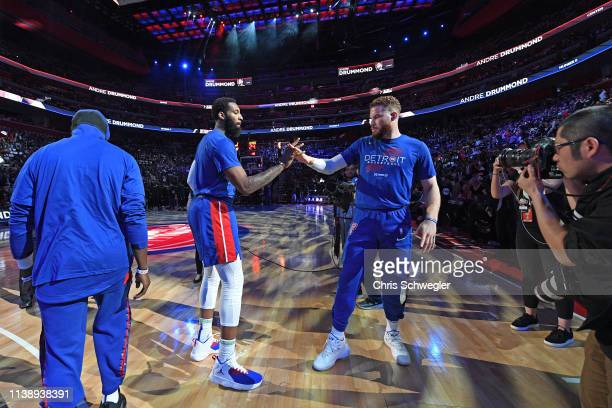 Andre Drummond and Blake Griffin of the Detroit Pistons high five before Game Four of Round One against the Milwaukee Bucks during the 2019 NBA...