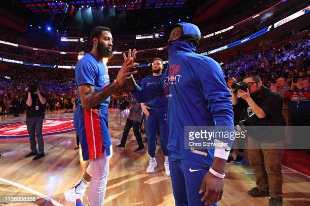 Andre Drummond and Reggie Jackson of the Detroit Pistons high five before Game Four of Round One against the Milwaukee Bucks during the 2019 NBA...