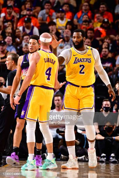 Andre Drummond hi-fives Alex Caruso of the Los Angeles Lakers during the game against the Phoenix Suns during Round 1, Game 5 of the 2021 NBA...