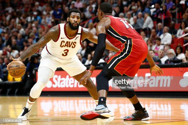 Andre Drummond of the Cleveland Cavaliers dribbles against Bam Adebayo of the Miami Heat during the first half at American Airlines Arena on February...