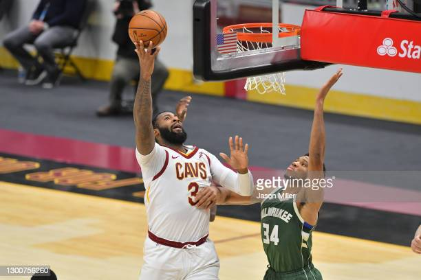Andre Drummond of the Cleveland Cavaliers drives to the basket against Giannis Antetokounmpo of the Milwaukee Bucks during the fourth quarter at...
