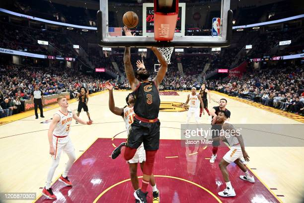 Andre Drummond of the Cleveland Cavaliers scores over Damian Jones of the Atlanta Hawks during the second half at Rocket Mortgage Fieldhouse on...