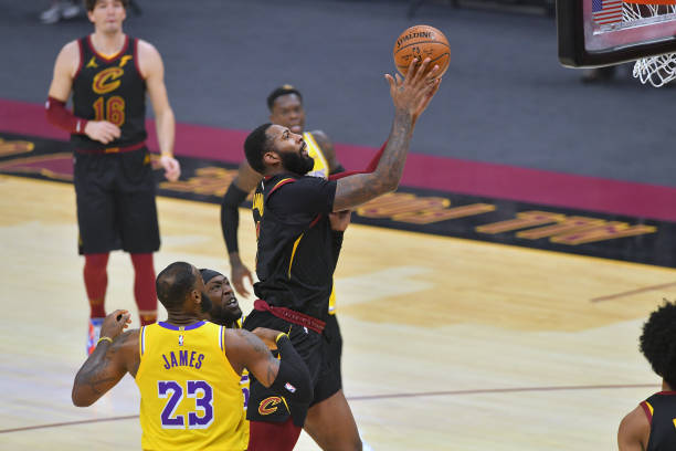Andre Drummond of the Cleveland Cavaliers shoots over LeBron James of the Los Angeles Lakers during the first quarter at Rocket Mortgage Fieldhouse...