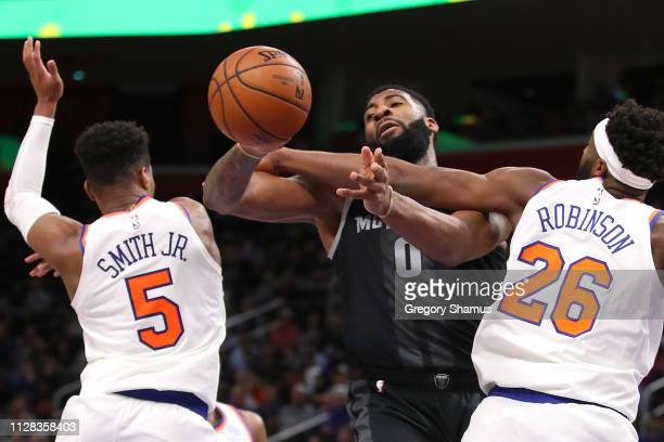 Andre Drummond of the Detroit Pistons battles for the ball with Mitchell Robinson and Dennis Smith Jr #5 of the New York Knicks during the second...