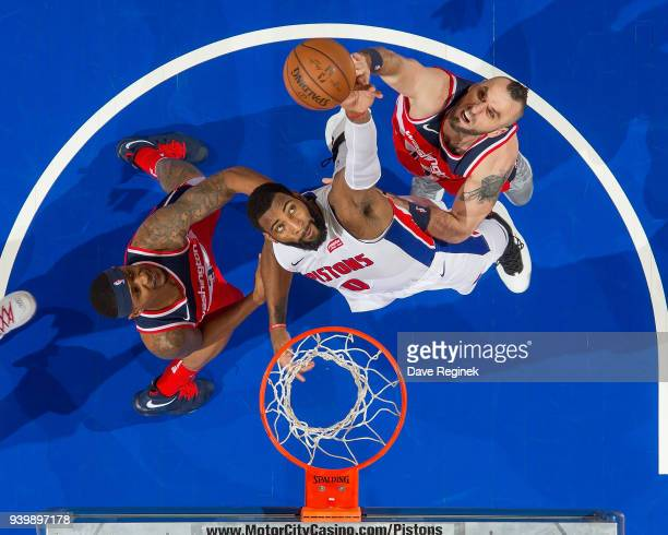 Andre Drummond of the Detroit Pistons battles for the rebound with Marcin Gortat and Bradley Beal of the Washington Wizards during an NBA game at...
