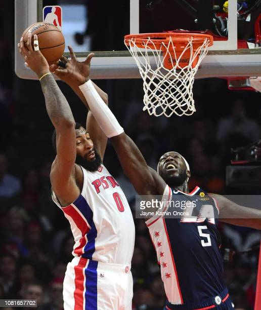 Andre Drummond of the Detroit Pistons beats Montrezl Harrell of the Los Angeles Clippers to a rebound in the second half of the game at Staples...