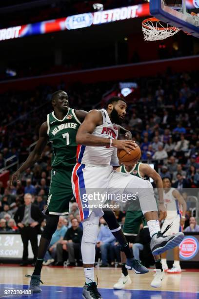 Andre Drummond of the Detroit Pistons beats Thon Maker of the Milwaukee Bucks to a rebound during the second half at Little Caesars Arena on February...
