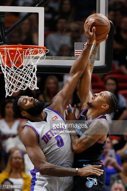 Andre Drummond of the Detroit Pistons blocks a shot by Rodney McGruder of the Miami Heat during the first half at American Airlines Arena on February...