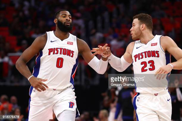 Andre Drummond of the Detroit Pistons celebrates a second half basket with Blake Griffin while playing the Atlanta Hawks at Little Caesars Arena on...