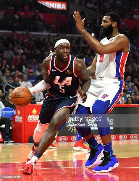 Andre Drummond of the Detroit Pistons defends Montrezl Harrell of the Los Angeles Clippers in the game against the Detroit Pistons at Staples Center...