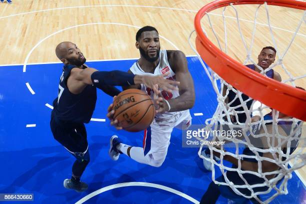 Andre Drummond of the Detroit Pistons drives to the basket against the Minnesota Timberwolves on October 25 2017 at Little Caesars Arena in Detroit...