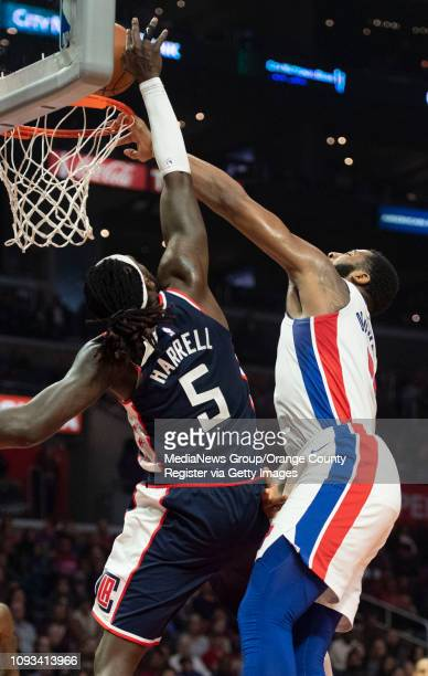 Andre Drummond of the Detroit Pistons dunks on Montrezl Harrell of the LA Clippers during their NBA basketball game at Staples Center in Los Angeles...