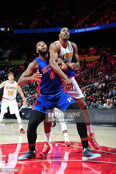 Andre Drummond of the Detroit Pistons fights for position against Dwight Howard of the Atlanta Hawks on December 2 2016 at Philips Arena in Atlanta...