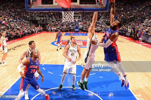 Andre Drummond of the Detroit Pistons goes to the basket against the Milwaukee Bucks during Game Four of Round One of the 2019 NBA Playoffs on April...