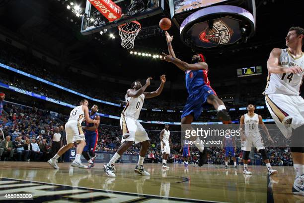 Andre Drummond of the Detroit Pistons goes up for the layup against the New Orleans Pelicans during an NBA game on December 11 2013 at the New...
