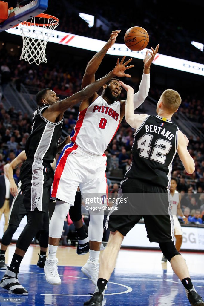 Andre Drummond #0 of the Detroit Pistons grabs a first half rebound between Dewayne Dedmon #3 and Davis Bertans #42 of the San Antonio Spurs at the Palace of Auburn Hills on February 10, 2017 in Auburn Hills, Michigan.