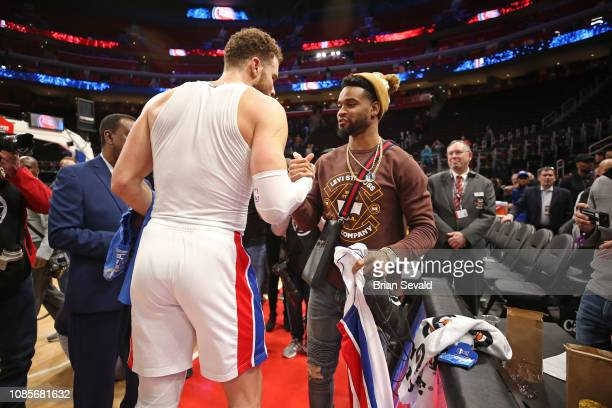 Andre Drummond of the Detroit Pistons greets Darius Slay of the Detroit Lions after the game against the Orlando Magic on January 16 2019 at Little...