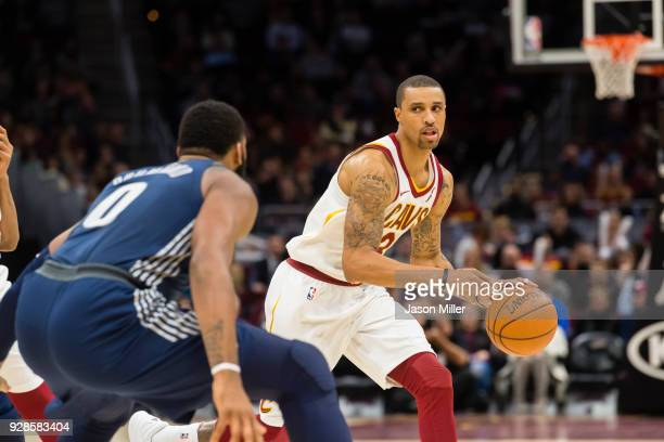Andre Drummond of the Detroit Pistons guards George Hill of the Cleveland Cavaliers during the second half at Quicken Loans Arena on March 5 2018 in...