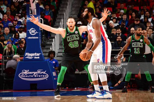 Andre Drummond of the Detroit Pistons handles the ball against Aron Baynes of the Boston Celtics on December 10 2017 at Little Caesars Arena in...