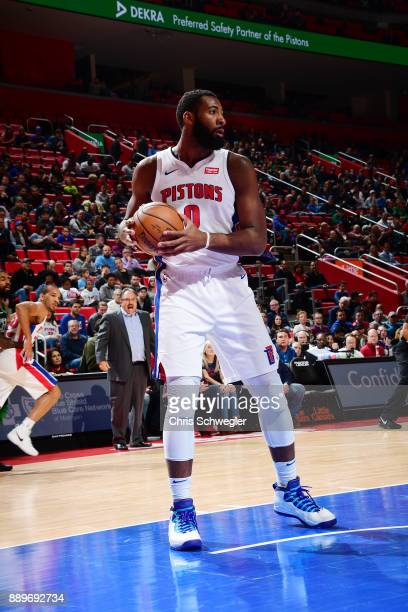 Andre Drummond of the Detroit Pistons handles the ball against the Boston Celtics on December 10 2017 at Little Caesars Arena in Detroit Michigan...