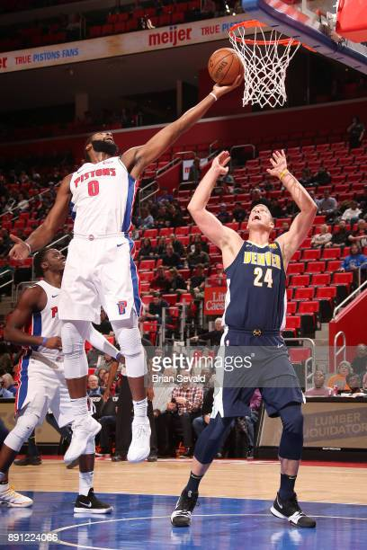 Andre Drummond of the Detroit Pistons handles the ball against the Denver Nuggets on December 12 2017 at Little Caesars Arena in Detroit Michigan...