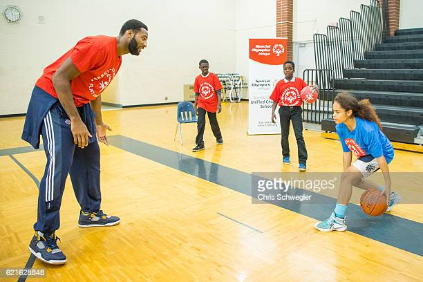 Andre Drummond of the Detroit Pistons helps host a special olympics ambassador announcement at Fisher Magnet Upper Academy on November 3 2016 in...