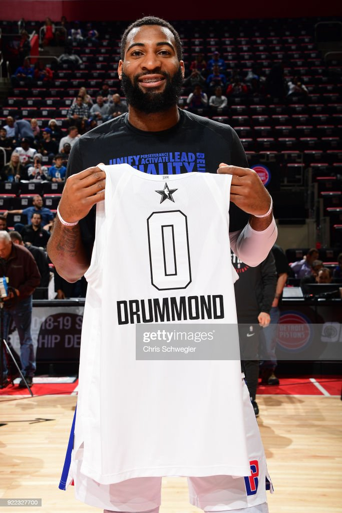 Andre Drummond #0 of the Detroit Pistons holds up his all star jersey before the game against the Atlanta Hawks on February 14, 2018 at Little Caesars Arena in Detroit, Michigan.