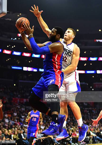 Andre Drummond of the Detroit Pistons is fouled by Blake Griffin of the Los Angeles Clippers as he attempts a layup during the first half at Staples...
