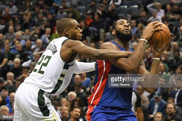 Andre Drummond of the Detroit Pistons is fouled by Khris Middleton of the Milwaukee Bucks during a game at the Bradley Center on December 6 2017 in...