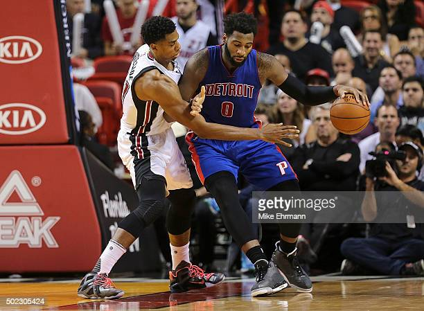 Andre Drummond of the Detroit Pistons posts up Hassan Whiteside of the Miami Heat during a game at American Airlines Arena on December 22 2015 in...