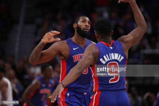 Andre Drummond of the Detroit Pistons reacts to a fourth quarter play with Langston Galloway while playing the Brooklyn Nets during the home opener...