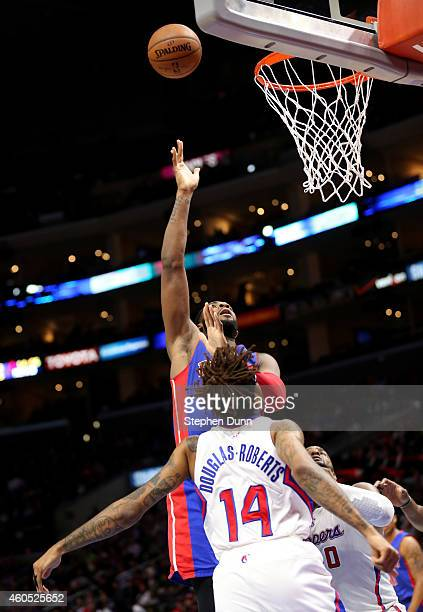 Andre Drummond of the Detroit Pistons shoots over Chris DouglasRoberts of the Los Angeles Clippers at Staples Center on December 15 2014 in Los...